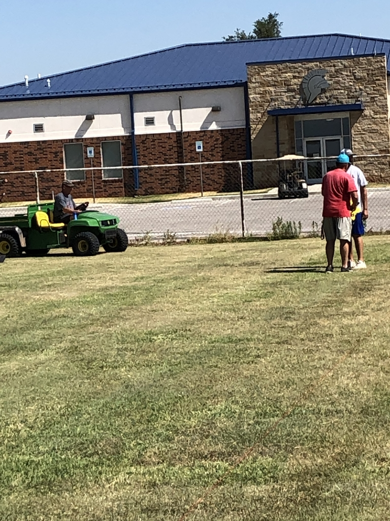 Coaches getting practice field ready.